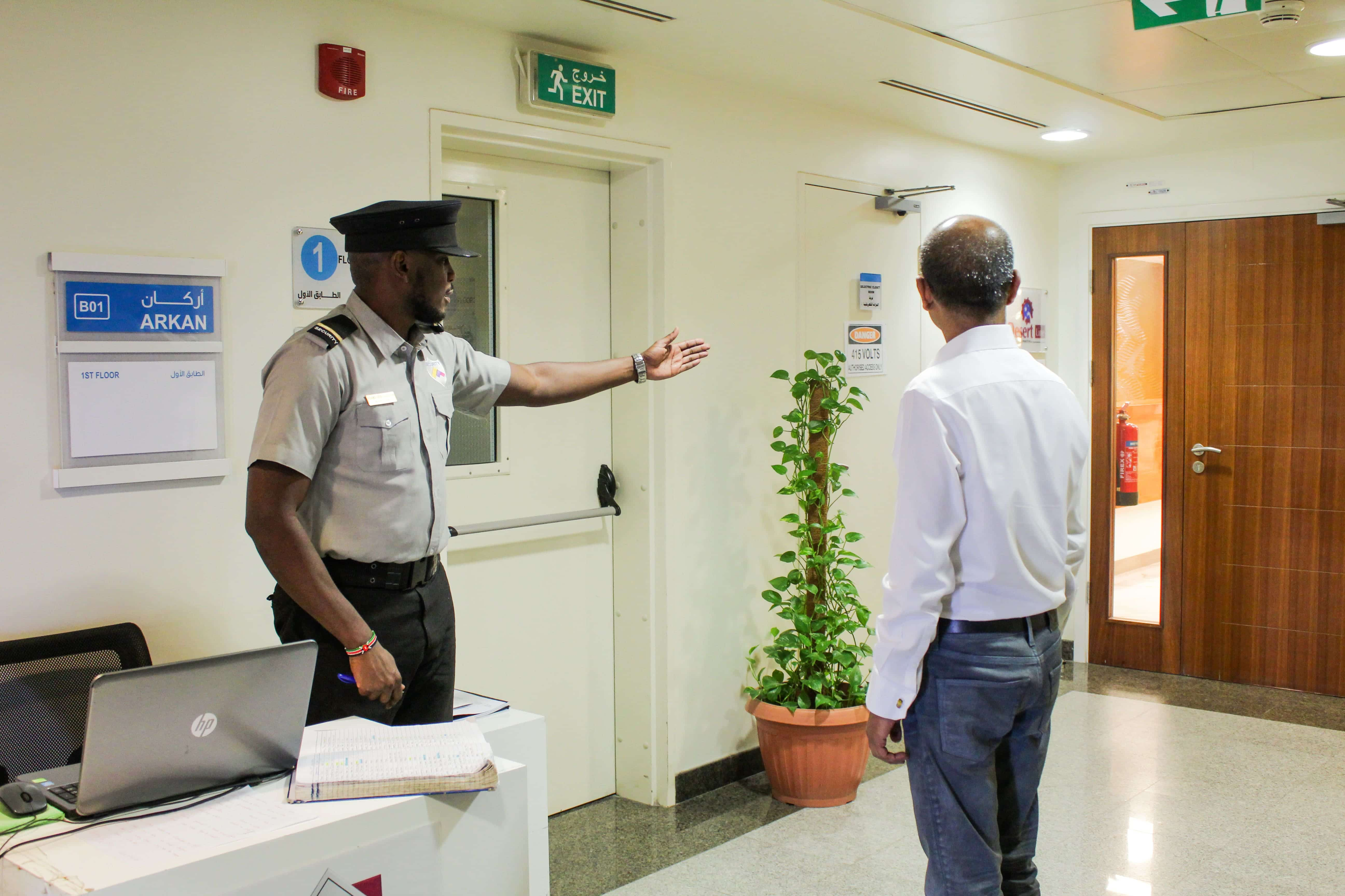 SECURITY GUIDING GUESTS TO CORPORATE HEAD OFFICE